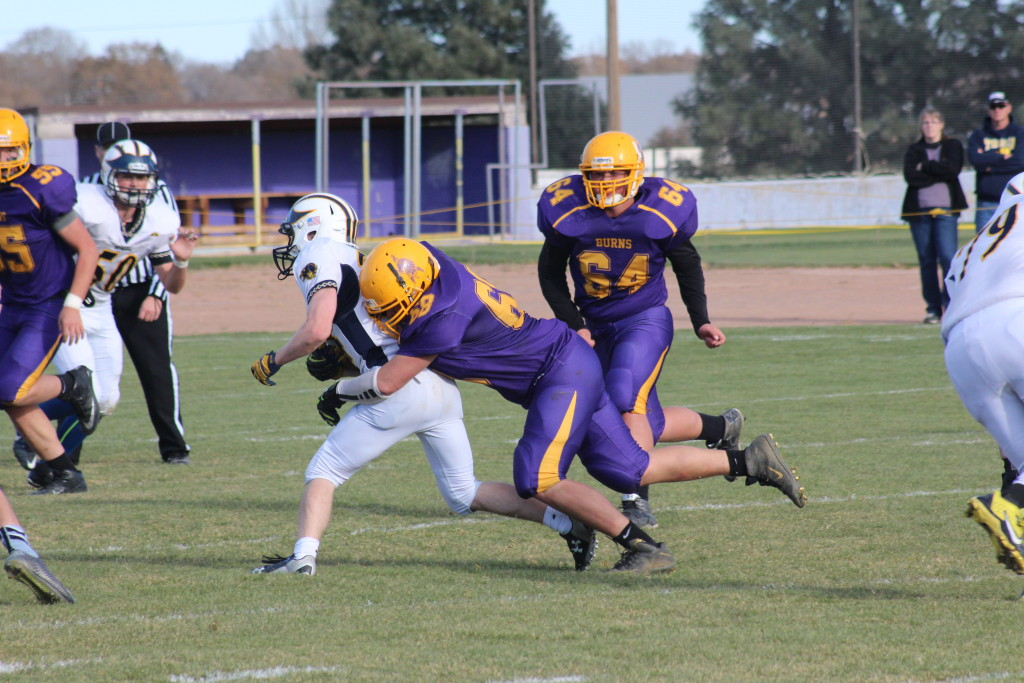 Taylor Klus of Burns brings down the ball carrier. Photo by JEFF GRAHAM