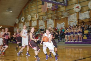 Carli Feist of Burns dribbles through traffic under the basket. (Photo by RANDY PARKS)
