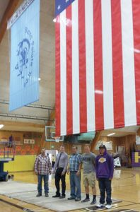 From left to right: Harney County School District No. 3 Facilities and Transportation Supervisor Wade Peasley, former Burns High School Principal Brandon Yant, Lynn Morgan of Morgan Rolling Flags, Ty Wayne Reid and Anthony Purcella.