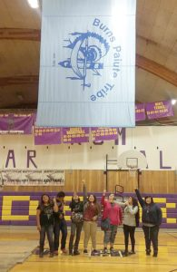Submitted photo Members of last year's Burns High School (BHS) Native American Club celebrate the installation of the tribal flag in the BHS gymnasium. From left to right: Mileah Skunkcap, Anthony Purcella, Michael Teeman, Ambrosia Snapp, Destiny Teeman, Lae Purcella, Deanne Teeman. Not pictured: Esperanza Ceja.