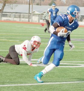 Moda Player of the Game, Cashe Davis, sidesteps a defender on his way to the end zone. (Photos by LINDY WILLIAMS)