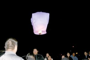 Several large, lighted luminaries were released to honor victims of domestic violence. (Submitted photo)