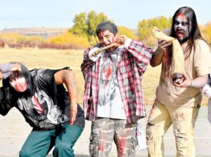 Some of the 'walking dead' who participated in Harney County's first-ever Zombie Walk to raise awareness for domestic violence and breast cancer. (Submitted photo)